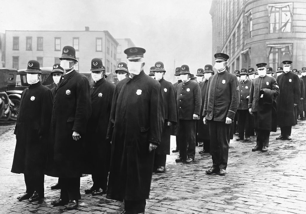 """Policemen in Seattle wearing masks made by the Red Cross, during the influenza epidemic. December 1918."" (Wikipedia)"